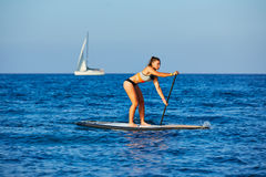 SUP Stand up Surf girl with paddle Stock Photo