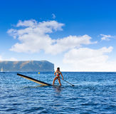SUP Stand up Surf girl with paddle Royalty Free Stock Image