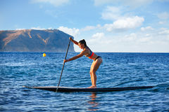 SUP Stand up Surf girl with paddle Royalty Free Stock Photography