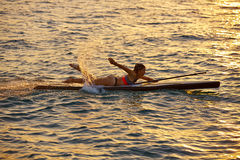 SUP Stand up Surf girl with paddle Royalty Free Stock Images