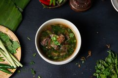 Sup tulang or bone soup, popular traditional malay dish. In restaurant stock photos