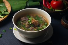 Sup tulang or bone soup, popular traditional malay dish. With background stock photos