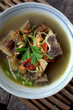 Sup Tulang. Is the Malaysian version of bone broths. It is a traditional recipe, a humble but nutritious broth eaten for generations as comfort food. garnish stock photos