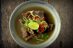Sup Tulang. Is the Malaysian version of bone broths. It is a traditional recipe, a humble but nutritious broth eaten for generations as comfort food. garnish stock image