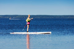 Sup - woman on stand up paddle board. In the lake Stock Photography
