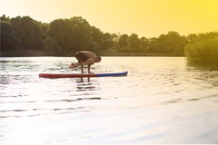 SUP Yoga stand up paddling board Stock Image