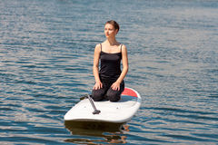 SUP young beautiful girl yoga meditation06 Royalty Free Stock Photography