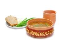 Sup in zolla dell'argilla Fotografia Stock