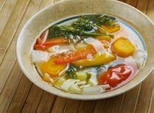 Supa taraneasca. Romanian vegetable soup with noodles Stock Photo