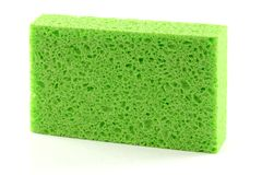 Super Absorbent & Anti bacterial cellulose sponge. A clean green Super Absorbent & Anti bacterial cellulose sponge on white background royalty free stock images