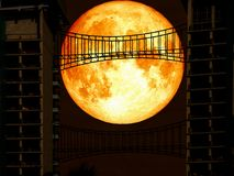 Super blue blood moon back middle metal bridge. Elements of this image furnished by NASA Stock Photo