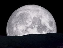 Super blue moon back middle on mountain. Elements of this image furnished by NASA Royalty Free Stock Photos