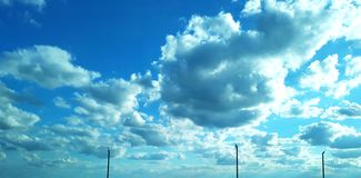 Super blue sky. A beautiful and cheerful sky with clouds stock photography