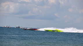 Super Boat Offshore Races (Hooters - Twisted Metal - GEICO). This is a photo of super boat Hooters, Twisted Metal, and GEICO in an offshore race royalty free stock photos