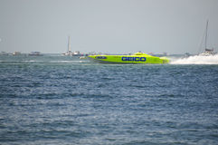 Super Boat Offshore Races (Miss GEICO). CLEARWATER, FL/USA - SEPTEMBER 28: Super boat GEICO taking a warmup run prior to competing in an offshore race on royalty free stock image