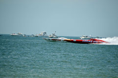Super Boat Races (Hooters vs Lucas Oil). This is a photo of super boat Hooters vs Lucas Oil  in an offshore race Royalty Free Stock Images