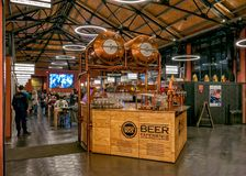 Food Market in Vila Nova de Gaia, Portugal. The Super Bock `Beer Experience` stand offering tastings of various types of beer in the fabulous Mercado Beira-Rio royalty free stock photo