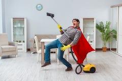 Super bohatera cleaner pracuje w domu Obrazy Royalty Free