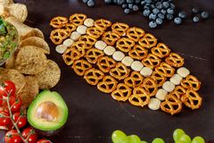 Super Bowl day party snacks for watching a football game. With chips and salsa royalty free stock photos