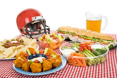 Super Bowl Party Food. Table set with munchies for a Super Bowl party. White background royalty free stock photo