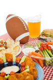 Super Bowl Party Table. Table set with snack foods for a Super Bowl party. (focus on football) Vertical view with white background stock photos