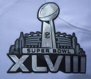 Super Bowl XLVIII logo na seattle seahawks drużyny mundurze przedstawiającym podczas super bowl XLVIII tygodnia w Manhattan Fotografia Stock
