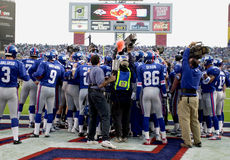 Super Bowl XXXV pre-game warm-up. New York Giants huddle up in their endzone.  (Image taken from color slide Royalty Free Stock Image