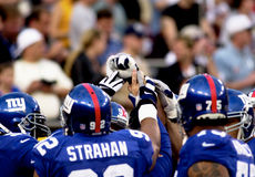 Super Bowl XXXV pre-game warm-up. New York Giants huddle up in their endzone.  (Image taken from color slide Royalty Free Stock Images