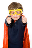 Super boy. Young child in a super hero costume with his arms out on a white background stock photography