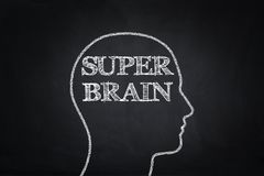 Super brain human head drawing on blackboard.  Stock Images