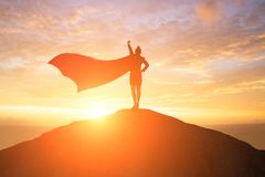 Super business woman on mountain royalty free stock images