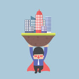 Super businessman carrying the city Royalty Free Stock Images