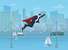 Super businessman dressed as a super hero flying over modern city landscape background. Stock Image