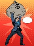 Super businessman hero with a bag of money Stock Photos