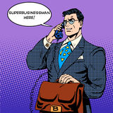 Super businessman hero talking phone success Stock Images