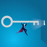 Super Businessman Lifting Giant Key of Success Royalty Free Stock Photo