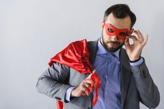 super businessman posing in mask and cape stock images