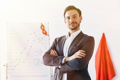 super businessman standing with crossed arms near mask and cape stock photos