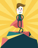 Super businessman standing on the peak of the mountain. Royalty Free Stock Photos