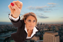 Super businesswoman. Flying over London city stock photos