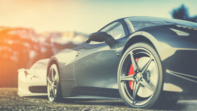 Super car parked in the mountains in the morning. Royalty Free Stock Photo