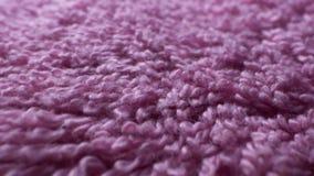 Super closeup. Details of a pink terry towel. Textile background