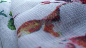 Super close up. Details of silk fabric with floral print. texture background