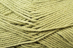 Split Pea Green Yarn Texture Close Up. A super close up image of split pea green yarn Royalty Free Stock Images