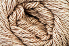 Tan Yarn Texture Close Up. A super close up image of tan yarn Stock Photo