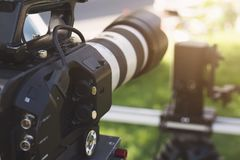 Super close up of Professional Video Camera. The Focus is on the lens and the front part royalty free stock photos