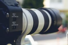 Super close up of Professional Video Camera. The Focus is on the lens and the front part stock image