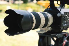 Super close up of Professional Video Camera. The Focus is on the lens and the front part royalty free stock image