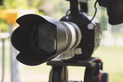 Super close up of Professional Video Camera. The Focus is on the lens and the front part stock images