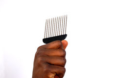 Super comb. This is an image of a hand holding a comb royalty free stock photos